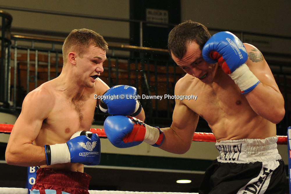 Freddie Turner (claret & blue shorts) defeats Kevin McCauley in a 6x3 min rounds Welterweight contest at York Hall, Bethnal Green, London on 14th December 2011. Frank Warren Promotions. Photo credit: © Leigh Dawney 2011.