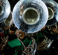 Marching band tuba players pause while getting ready to take the field in a battle of the bands in Moorpark Californa.