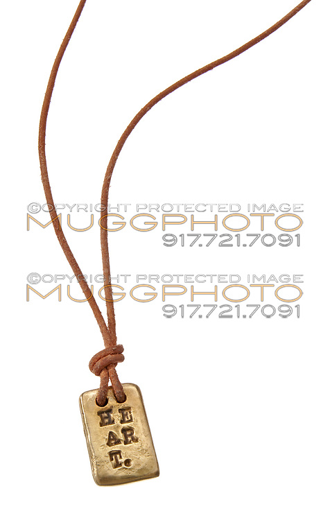 Gold heart necklace on white background