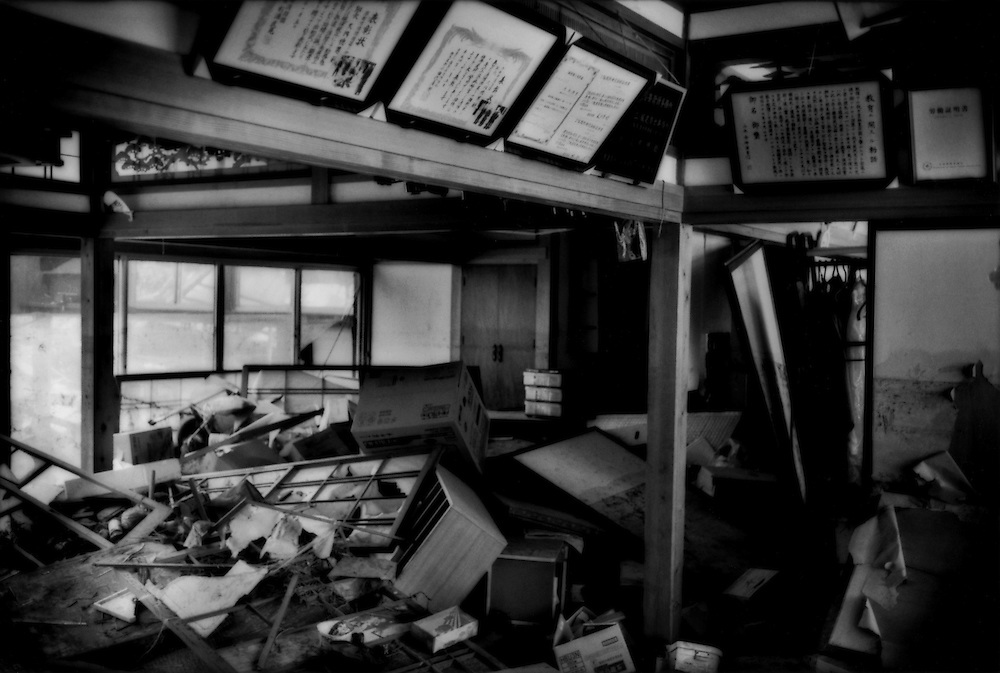 Interior ramsacked by the 11 March tsunami remains untouched because it sits inside the 20km (12.4 miles) nuclear no-entry zone, hobbling the ability of authorities to conduct clean up operations because of fears of radioactivity.  Near Odaka, Fukushima Prefecture, Japan.  As of midnight 21 April 2011, the Japanese government declared the no-entry zone off-limits under the Disaster Countermeasures Basic Law which gives the police the power to detain anyone entering the zone for up to 30 days and impose a fine of up 100,000 JPY (US$1,200), which was exactly the risk necessary to take to make this photograph..