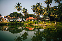 Fort Kochi, India -- February 13, 2018: Reflections in a small water pond.