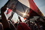 Jubilant crowds hear news of Egyptian president Morsi's arrest. Tahrir Square, Cairo, Egyot.