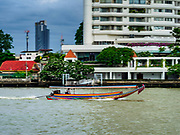 19 JULY 2018 - BANGKOK, THAILAND: A long tail boat speeds up the Chao Phraya River towards downtown Bangkok. Long tailed boats are iconic forms of river transport in Thailand.     PHOTO BY JACK KURTZ