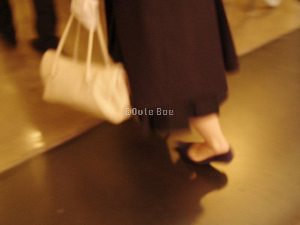 cropped view of woman walking