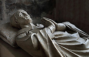 Effigy of Geoffroy Fae, bishop of Evreux, 14th century, in the abbey church, originally the 17th century Mauric refectory, recently restored, at the Abbaye Notre-Dame du Bec or Bec Abbey, a Benedictine monastery founded 1034 by Saint Herluin, in Le Bec Hellouin, Eure, Normandy, France. The abbey church was built in the 14th century, the Tour Saint-Nicolas in the 15th century and the current complex contains a 17th century chapter house and cloister and 18th century Regency style convent buildings. The abbey is listed as a historic monument. Picture by Manuel Cohen