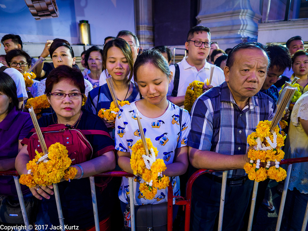 09 NOVEMBER 2017 - BANGKOK, THAILAND: People gather before dawn to pray at the Erawan Shrine on the 61st anniversary of the shrine's dedication. The Erawan Shrine is one of the most popular shrines in Bangkok. It was dedicated on November 9, 1956, after a series of construction accidents at what was then the Erawan Hotel (since torn down and replaced by the Grand Hyatt Erawan Hotel). The statue in the shrine is Phra Phrom, the Thai representation of the Hindu god of creation Brahma. It is a Hindu shrine popular with Thai and Chinese Buddhists because it is thought that making an offering to the Phra Phrom will bring good fortune.    PHOTO BY JACK KURTZ