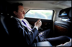 The Prime Minister David Cameron traveling back in his car to WOCA during the Libya crisis, Friday April 15, 2011. Photo By Andrew Parsons/ Parsons MediaThe Prime Minister David Cameron traveling back in his official car to his West Oxfordshire office on his blackberry during the Libya crisis, Friday April 15, 2011. Photo By Andrew Parsons/ i-Images