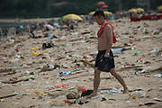 SHENZHEN, CHINA - JUNE 03: (CHINA OUT) <br /> <br /> Trashes Scatter On Beach After Holiday In China<br /> <br /> People rest on the trash-surrounded beach at Dameisha Beach Park on June 3, 2014 in Shenzhen, Guangdong Province of China. Nearly 500,000 tourists came to Dameisha Beach Park during the International Children\'s Festival and the Dragon Boat Festival on a 3-day holiday from May 31 to June 2, which made this beach full of trashes. <br /> ©Exclusivepix