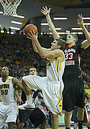 December 04 2010: Iowa Hawkeyes guard Eric May (25) puts up a shot as Idaho State Bengals center Deividas Busma (33) defends during the second half of their NCAA basketball game at Carver-Hawkeye Arena in Iowa City, Iowa on December 4, 2010. Iowa won 70-53.
