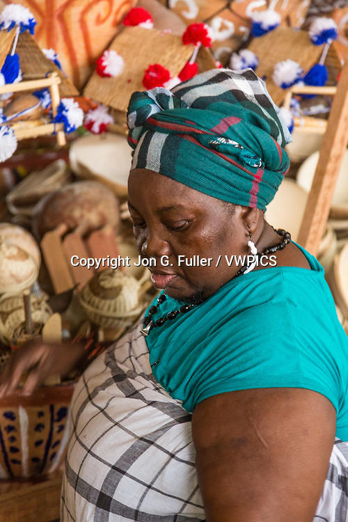 A woman sells handicrafts in the market in Paramaribo, Suriname.