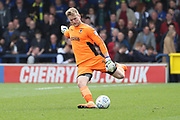 AFC Wimbledon goalkeeper George Long (1) clearing the ball during the EFL Sky Bet League 1 match between AFC Wimbledon and Scunthorpe United at the Cherry Red Records Stadium, Kingston, England on 7 April 2018. Picture by Matthew Redman.