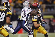 PITTSBURGH - JANUARY 23:  Wide receiver Deion Branch #83 of the New England Patriots catches 1 of 4 passes for 116 yards while defended by safety Troy Polamalu #43 of the Pittsburgh Steelers during the AFC Championship game at Heinz Field on January 23, 2005 in Pittsburgh, Pennsylvania. The Pats defeated the Steelers 41-27. ©Paul Anthony Spinelli  *** Local Caption *** Deion Branch; Troy Polamalu