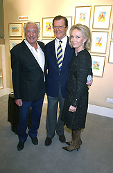 Left to right, MICHAEL WINNER, actor ROGER MOORE and his wife KIKI  THOLSTRUP at an exhibition of postcards by the late Donald McGill hosted by Michael Winner at Chris Beetles, 8&10 Ryder Street, London SW1 on 14th March 2006.<br />