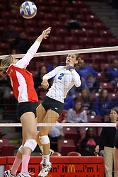 29 October 2011: Laruel Sanford slams the ball past the Redbirds front line During a match between the Creighton Bluejays and the Illinois State Redbirds at Redbird Arena in Normal Illinois