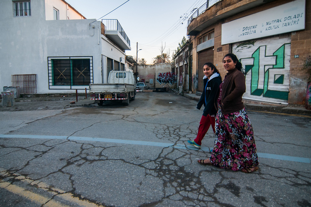 Two girls walk next to the wall that divide the city of Nicosia, Cyprus.<br /> Nicosia was divided into the southern Greek Cypriot and the northern Turkish Cypriot parts in 1963, following the intercommunal violence that broke out in the city. Today, the northern part of the city is the capital of Northern Cyprus, a de facto state that is considered to be occupied Cypriot territory by the international community. &copy;Simone Padovani / Awakening