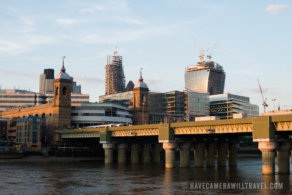 London Bridge in the foreground, with new highrises being constructed in the City of London in the background.