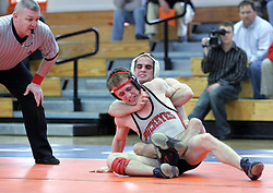 Anthony Burke places Ohio State's Nathan Costello into a headlock while holding his arm back.  Burke won the 125lb. weight match, but UVA lost the dual meet 28-10.