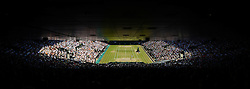 © London News Pictures. 07/07/2013 . London, UK. Andy Murray (bottom) in action during the men's singles final against Novak Djokovic (top) of Serbia at the Wimbledon Lawn Tennis Championships. Andy Murray won the match becoming the first British male to win the tournament in 77 years. Photo credit: Mike King/LNP