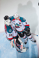 KELOWNA, CANADA - APRIL 8: Gordie Ballhorn #4 congratulates Michael Herringer #30 of the Kelowna Rockets on the game win against the Portland Winterhawks on April 8, 2017 at Prospera Place in Kelowna, British Columbia, Canada.  (Photo by Marissa Baecker/Shoot the Breeze)  *** Local Caption ***