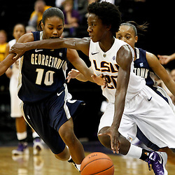 November 16, 2011; Baton Rouge, LA; LSU Tigers guard Destini Hughes (20) is defended by Georgetown Hoyas guard Taylor Brown (10) during the second half of a game at the Pete Maravich Assembly Center. LSU defeated Georgetown 51-40. Mandatory Credit: Derick E. Hingle-US PRESSWIRE