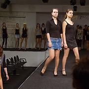 Russian model students practice on the catwalk at the Slava Zaitsev agency in Moscow. Slava Zaitsev, king of fashion during the Soviet times, re-invented his brand after the Iron Curtain collapsed, creating a modeling school and fashion house in the centre of Moscow. .Russia supplies many models to the West. ..Photograph by Justin Jin