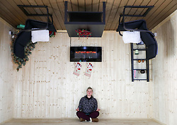 An employee in one of the rooms in 'The Upside Down House', a zero-gravity illusion experience, in The Triangle in Bournemouth, Dorset.