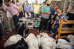 60360913  <br /> Egyptians stand beside dead bodies at a mosque where lines of bodies wrapped in shrouds were laid out in Cairo, Egypt, August 15, 2013. At least 525 were killed and 3,717 others injured across Egypt in clashes between supporters of ousted President Mohamed Morsi and the security troops, after the latter dispersed Wednesday two major pro-Morsi sit-ins in Cairo and Giza, a Health Ministry official said Thursday, August 15, 2013. <br /> Picture by imago / i-Images<br /> UK ONLY