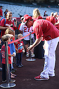 ANAHEIM, CA - JUNE 6:  Josh Hamilton #32 of the Los Angeles Angels of Anaheim signs autographs before the game against the Chicago White Sox at Angel Stadium on Friday, June 6, 2014 in Anaheim, California. The Angels won the game 8-4. (Photo by Paul Spinelli/MLB Photos via Getty Images) *** Local Caption *** Josh Hamilton