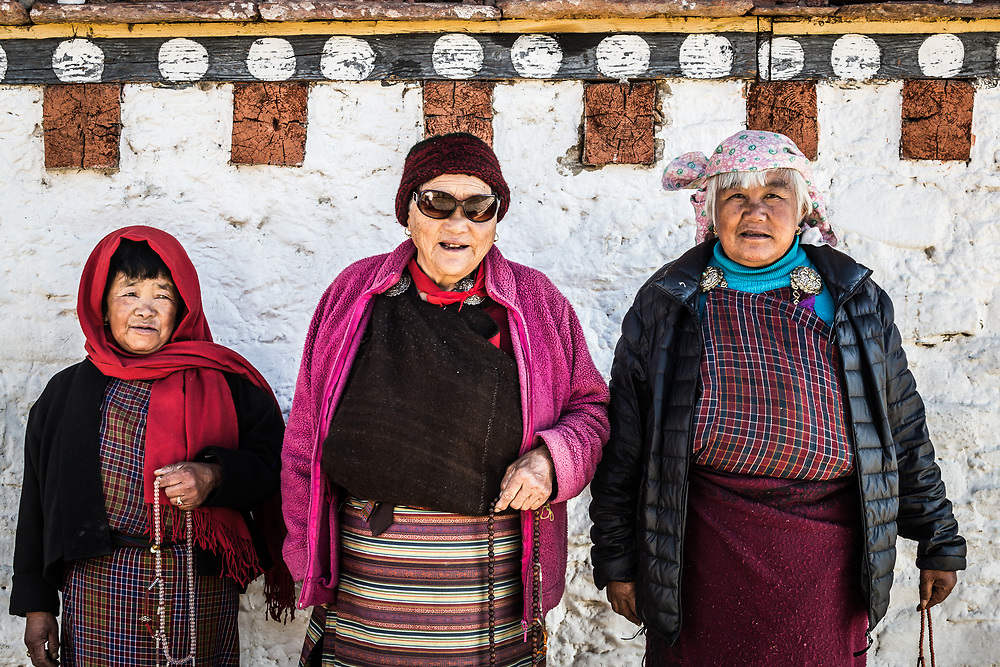 Morning prayers is a way of life. Buddhist devotees in Bhumtang, Bhutan. A group of friends stop for a photo.