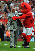 Alex Ferguson hugs with the club mascot before the Premier League match between Manchester United and Birmingham City at Old Trafford on 16th August 2009.