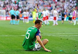 Jonny Evans of Northern Ireland its a frustrated figure on the final whistle  - Mandatory by-line: Joe Meredith/JMP - 12/06/2016 - FOOTBALL - Stade de Nice - Nice, France - Poland v Northern Ireland - UEFA European Championship Group C