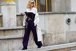 Street style, Elina Halimi arriving at Haider Ackermann Fall-Winter 2018-2019 show held at Palais de Chaillot, in Paris, France, on March 3rd, 2018. Photo by Marie-Paola Bertrand-Hillion/ABACAPRESS.COM