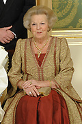 Queen Beatrix pose for the media before the statebanquet at palace Noordeinde in The Hague.