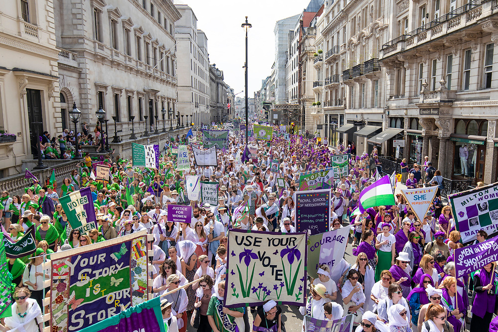 © Licensed to London News Pictures. 10/06/2018. London, UK. Thousands of people march through central London wearing green, white and violet, the colours of the Suffragette movement, as part of mass participation artwork PROCESSIONS to celebrate 100 years votes for women. Photo credit: Rob Pinney/LNP