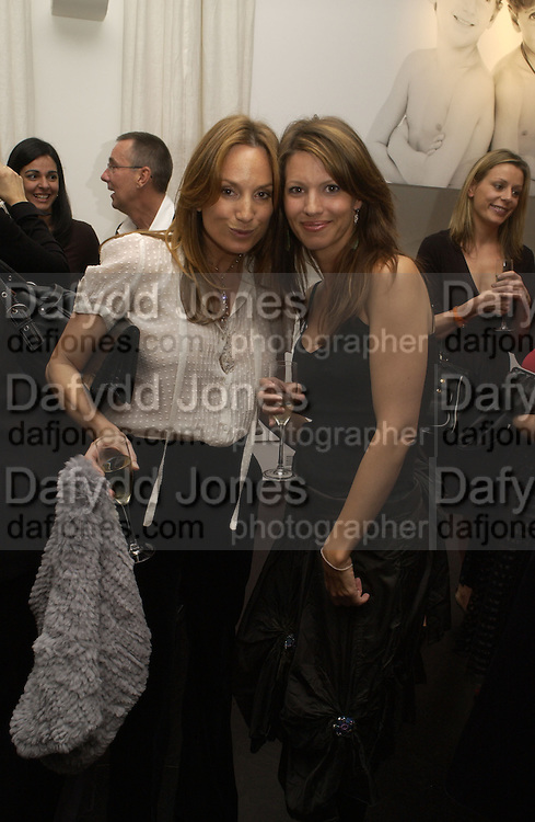 EMILY OPPENHEIMER AND LAUREN BOOTH. A photo exhibition in support of Facing the World <br />Hosts: Christopher Bailey with Eliane Fattal, Yasmin Mills, Emily Oppenheimer Turner, Catherine Prevost and Elizabeth Saltzman Walker.  Burberry, 18 - 22 Haymarket, SW1  .  9 November 2005. ONE TIME USE ONLY - DO NOT ARCHIVE © Copyright Photograph by Dafydd Jones 66 Stockwell Park Rd. London SW9 0DA Tel 020 7733 0108 www.dafjones.com