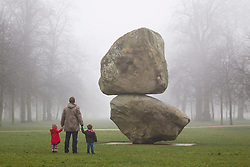 © Licensed to London News Pictures. 08/03/2013. London, UK. Visitors to Hyde Park view a giant boulder sculpture entitled 'Rock on Top of Another Rock' by Swiss artists Fischli/Weiss in outside the Serpentine Gallery in London, today (08/03/2013). The installation, which was unveiled today, is the first sculpture by the artists - Peter Fischli (b. 1952) and David Weiss (1946-2012) to be presented in the UK.  Photo credit: Matt Cetti-Roberts/LNP