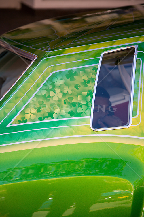 Detail of a colorful Low Rider Car with a person looking out a window