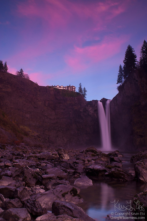 The flow over Snoqualmie Falls, Washington, is relatively low before the autumn storms arrive. Here, the flow is about half the annual average. Salish Lodge, a popular tourist resort, is visible on the cliff above the waterfall.
