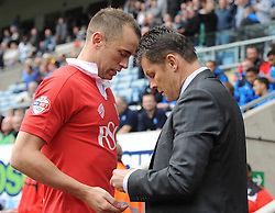 Bristol City manager, Steve Cotterill with Bristol City's Aaron Wilbraham  - Photo mandatory by-line: Joe Meredith/JMP - Mobile: 07966 386802 - 18/10/2014 - SPORT - Football - Coventry - Ricoh Arena - Bristol City v Coventry City - Sky Bet League One