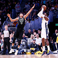 01 April 2018: Denver Nuggets forward Paul Millsap (4) takes a jump shot over Milwaukee Bucks forward Giannis Antetokounmpo (34) during the Denver Nuggets 128-125 victory over the Milwaukee Bucks, at the Pepsi Center, Denver, Colorado, USA.