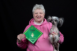 © Licensed to London News Pictures. 10/03/2016. Birmingham, UK. Diane Brearley with her Chinese Crested Hairless dog named Mousey at Crufts 2016 held at the NEC in Birmingham, West Midlands, UK. The world's largest dog show, Crufts is this year celebrating it's 125th anniversary. The annual event is organised and hosted by the Kennel Club and has been running since 1891. Photo credit : Ian Hinchliffe/LNP