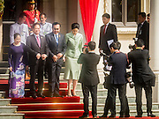 23 JULY 2015 - BANGKOK, THAILAND: NGUYEN TAN DUNG (2nd from left), Prime Minister of Vietnam, and his wife, (left) accompany PRAYUTH CHAN-O-CHA, Prime Minister of Thailand, and his wife onto the grounds of Government House in Bangkok. The Vietnamese Prime Minister and his wife came to Bangkok for the 3rd Thailand - Vietnam Joint Cabinet Retreat. The Thai and Vietnamese Prime Minister discussed issues of mutual interest.      PHOTO BY JACK KURTZ