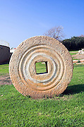 Herzliya city park, with ancient grindstones on display