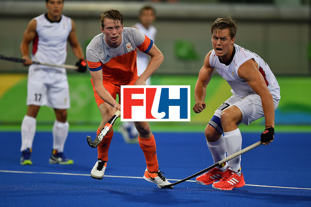 RIO DE JANEIRO, BRAZIL - AUGUST 16:  Tom Boon of Belgium (R) contests the ball with Seve Van Ass of the Netherlands (L) during the Men's semifinal hockey match Belgium vs Netherlands at the Olympic Hockey centre on August 16, 2016 in Rio de Janeiro, Brazil.  (Photo by Pascal Le Segretain/Getty Images)