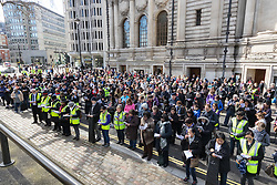 Westminster, London, March 25th 2016. Westminster's annual interdenominational Easter procession takes place with a procession from Methodist Central Hall to Westminster Cathedral and then on to Westminster Abbey, with the cross borne by people from The Passage, a homeless charity. PICTURED: Part of the gathering of Christians outside the Methodist Central Hall prior to the procession. <br /> ©Paul Davey<br /> FOR LICENCING CONTACT: Paul Davey +44 (0) 7966 016 296 paul@pauldaveycreative.co.uk