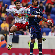 Tim Cahill, New York Red Bulls (left) and Sherjill MacDonald, challenge for a header  during the New York Red Bulls V Chicago Fire Major League Soccer regular season match at Red Bull Arena, Harrison. New Jersey. USA. 6th October 2012. Photo Tim Clayton