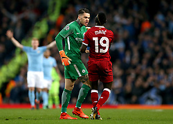 Manchester City goalkeeper Ederson (left) confronts Liverpool's Sadio Mane during the UEFA Champions League, Quarter Final at the Etihad Stadium, Manchester.