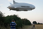UNITED KINGDOM, Bedfordshire: 17 August 2016 The worlds largest aircraft known as the Airlander 10 takes off for it's first ever test flight at Cardington, Bedfordshire. The 300 foot long vessel was built by British aerospace firm Hybrid Air Vehicles. Andrew Cowie / Story Picture Agency