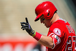 OAKLAND, CA - APRIL 13:  Mike Trout #27 of the Los Angeles Angels of Anaheim celebrates after hitting a single while wearing a black and gold version of the Nike batting glove in honor of Kobe Bryant's retirement during the third inning against the Oakland Athletics at the Coliseum on April 13, 2016 in Oakland, California. The Los Angeles Angels of Anaheim defeated the Oakland Athletics 5-1. (Photo by Jason O. Watson/Getty Images) *** Local Caption *** Mike Trout