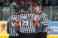 KELOWNA, CANADA - NOVEMBER 22: Game officials Kevin Crowell, Kevin Bennett and Dustin Minty converge at centre ice on November 22, 2014 at Prospera Place in Kelowna, British Columbia, Canada.  (Photo by Marissa Baecker/Shoot the Breeze)  *** Local Caption *** linesman; Kevin Crowell, Kevin Bennett; Dustin Minty;